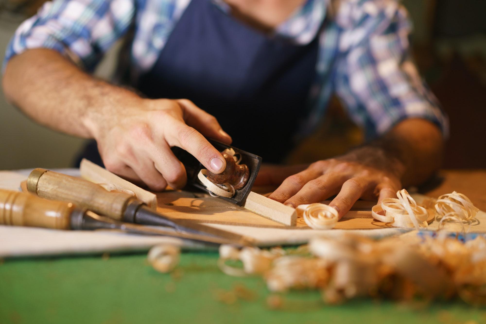 Artisan Lute Maker Chiseling Classical Guitar